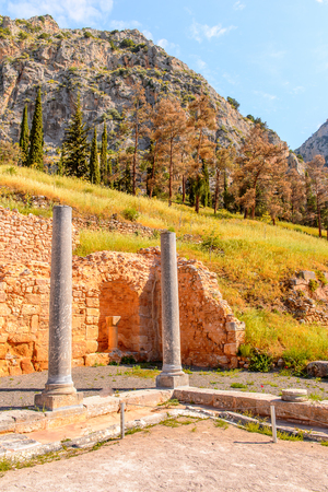 Columns in Delphi, an archaeological site in Greece, at the Mount Parnassus. Delphi is famous by the oracle at the sanctuary dedicated to Apollo. UNESCO World heritage