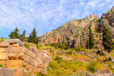 Ancient ruins of Delphi, an archaeological site in Greece, at the Mount Parnassus. Delphi is famous by the oracle at the sanctuary dedicated to Apollo. UNESCO World heritage Stock Photo