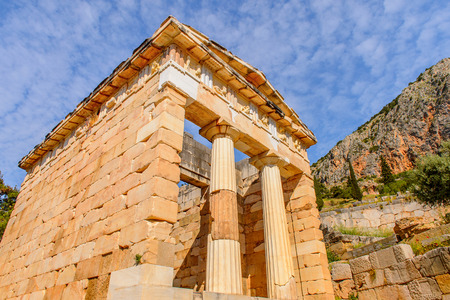 Athenian Treasury in Delphi, an archaeological site in Greece, at the Mount Parnassus. Delphi is famous by the oracle at the sanctuary dedicated to Apollo. UNESCO World heritage