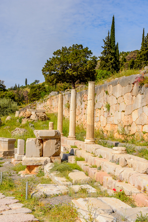 Ancient ruins of Delphi, an archaeological site in Greece, at the Mount Parnassus. Delphi is famous by the oracle at the sanctuary dedicated to Apollo