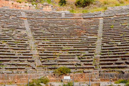 Amphitheater in Delphi, an archaeological site in Greece, at the Mount Parnassus. Delphi is famous by the oracle at the sanctuary dedicated to Apollo. Banco de Imagens