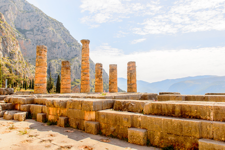 Apollo Temple in Delphi, an archaeological site in Greece, at the Mount Parnassus. Delphi is famous by the oracle at the sanctuary dedicated to Apollo