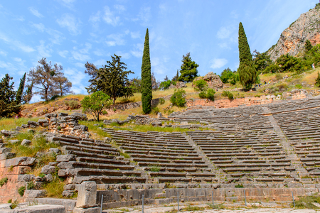 Amphitheater in Delphi, an archaeological site in Greece, at the Mount Parnassus. Delphi is famous by the oracle at the sanctuary dedicated to Apollo Stock Photo