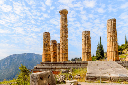 Apollo Temple in Delphi, an archaeological site in Greece, at the Mount Parnassus. Delphi is famous by the oracle at the sanctuary dedicated to Apollo. Stock Photo