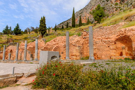 Columns in Delphi, an archaeological site in Greece, at the Mount Parnassus. Delphi is famous by the oracle at the sanctuary dedicated to Apollo.