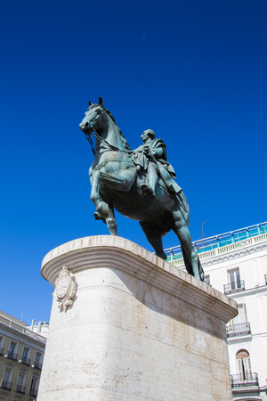 Monument to King Charles III on the Puerta del Sol, Madrid, Spain. Puerta del Sol is the centre (Km 0) of the radial network of Spanish roads. Stock Photo