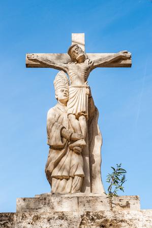 Statue on the Trinity bridge in Valencia, Spain Editorial