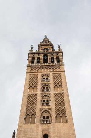 Giralda, a former minaret that was converted to a bell tower for the Cathedral of Seville in Seville Stock Photo