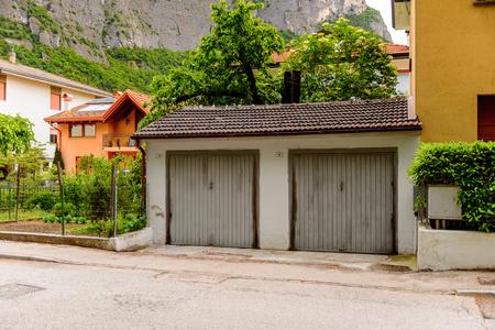 Alps mountains and Architecture of Mezzocorona, Italy.  A comune in Trentino in the northern Italian region Trentino-Alto Adige, Sudtirol Stock Photo