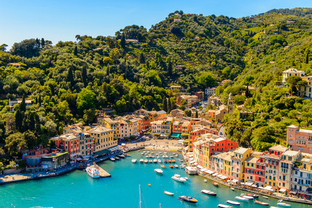 Aerial view of Portofino, is an Italian fishing village, Genoa province, Italy. A vacation resort with a picturesque harbour and with celebrity and artistic visitors.