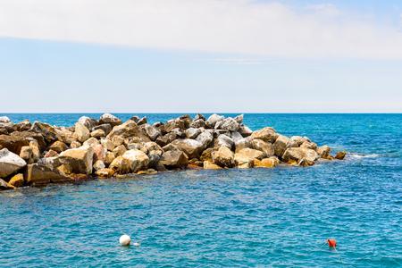 Boat at the coast of Manarola (Manaea), La Spezia, Liguria, Italy.