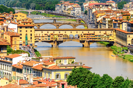 Ponte Vecchio (Old Bridge), a Medieval stone closed-spandrel segmental arch bridge over the Arno River, in Florence, Italy. View from the Michelangelo Square Stock Photo