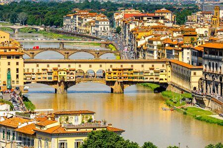 Ponte Vecchio (Old Bridge), a Medieval stone closed-spandrel segmental arch bridge over the Arno River, in Florence, Italy. View from the Michelangelo Square Stock Photo