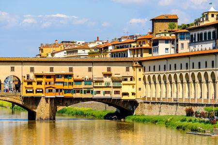 Ponte Vecchio (Old Bridge), a Medieval stone closed-spandrel segmental arch bridge over the Arno River, in Florence, Italy.