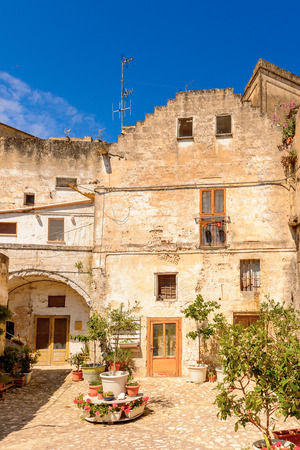 Houses in Matera, Puglia, Italy. The Sassi and the Park of the Rupestrian Churches of Matera. Фото со стока
