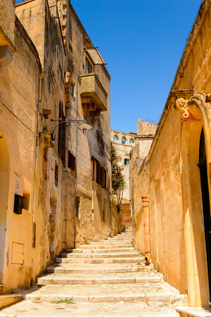 Street of Matera, Puglia, Italy. The Sassi and the Park of the Rupestrian Churches of Matera. Stock Photo