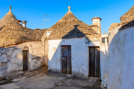 Typical trulli houses of Alberobello, a small town in Apulia, Italy. Stock Photo