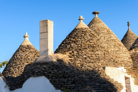 Typical trulli houses of Alberobello, a small town in Apulia, Italy. Stock Photo