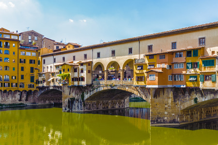 Ponte Vecchio (Old Bridge), a Medieval stone closed-spandrel segmental arch bridge over the Arno River, in Florence