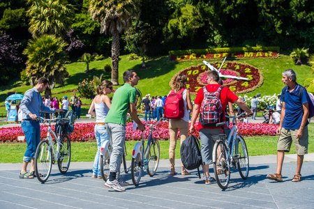 VINA DEL MAR, CHILE - NOV 9, 2014: Unidentified Chilean people on bicycles in Vina del Mar. Chilean people are of mixed Spanish and Amerindian descent