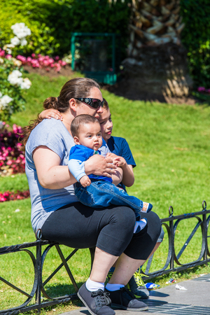 VINA DEL MAR, CHILE - NOV 9, 2014: Unidentified Chilean mother with two children in Vina del Mar. Chilean people are of mixed Spanish and Amerindian descent