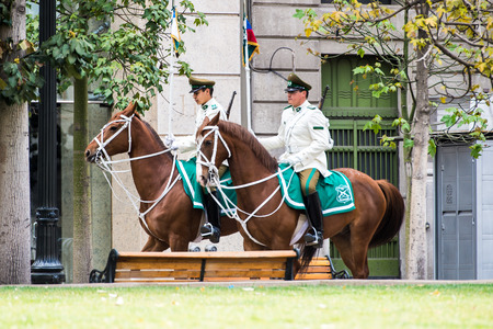 SANTIAGO, CHILE - NOV 1, 2014:  Unidentified Chilean policemen on horses in Santiago. Chilean people are mainly of mixed Spanish and Amerindian descent