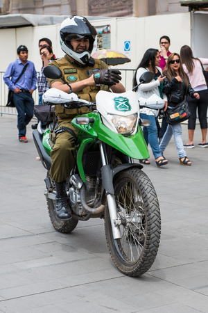 SANTIAGO, CHILE - NOV 1, 2014:  Unidentified Chilean man on the motorcycle. Chilean people are mainly of mixed Spanish and Amerindian descent