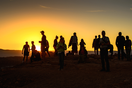 ATACAMA DESERT, CHILE - NOV 3, 2014: Unidentified tourists in the Atacama desert, Chile. Atacama Desert proper occupies 105,000 square kilometres Editorial