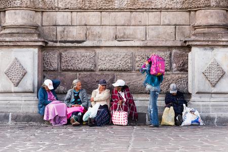 QUITO, ECUADOR - JAN 2, 2015: Unidentified Ecuadorian people in the street in Quito. 71,9% of Ecuadorian people belong to the Mestizo ethnic group