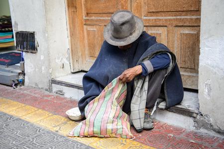 OTAVALO, ECUADOR - JAN 3, 2015: Unidentified Ecuadorian man in a black poncho and hat at the Otavalo Market. 71,9% of Ecuadorian people belong to the Mestizo ethnic group