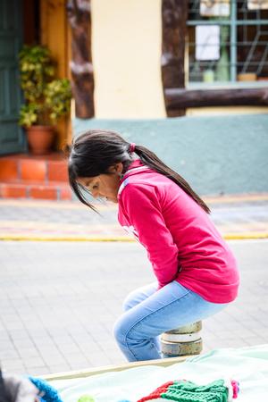 OTAVALO, ECUADOR - JAN 3, 2015: Unidentified Ecuadorian cute little girl at the Otavalo Market. 71,9% of Ecuadorian people belong to the Mestizo ethnic group Editorial
