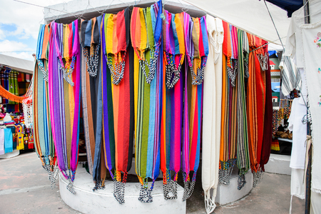OTAVALO, ECUADOR - JAN 7, 2015: Colorful Souvenirs of the Otavalo market  designed and built in 1970 by Dutch architect Tonny Zwollo Editorial
