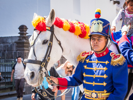 QUITO, ECUADOR - JAN 5, 2015: Unidentified Ecuadorian hussar with a horse during a parade in Quito 71,9% of Ecuadorian people belong to the Mestizo ethnic group