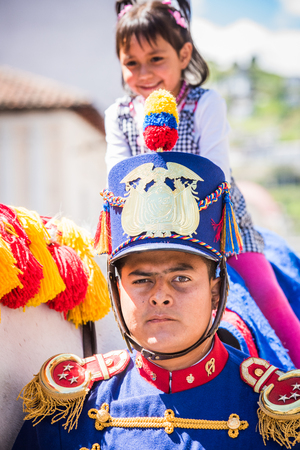 QUITO, ECUADOR - JAN 5, 2015: Unidentified Ecuadorian hussar during a parade in Quito 71,9% of Ecuadorian people belong to the Mestizo ethnic group Editorial