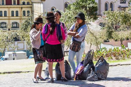 QUITO, ECUADOR - JAN 2, 2015: Unidentified Ecuadorian women with bowler hats. 71,9% of Ecuadorian people belong to the Mestizo ethnic group Éditoriale