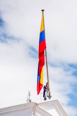 QUITO, ECUADOR - JAN 5, 2015: Unidentified Ecuadorian hussar establish the national flag of Ecuador in Quito. 71,9% of Ecuadorian people belong to the Mestizo ethnic group Editorial
