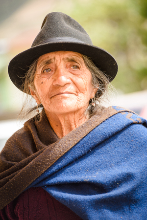 RIOBAMBA, ECUADOR - JAN 9, 2015: Unidentified Ecuadorian woman in traditional clothes. 71,9% of Ecuadorian people belong to the Mestizo ethnic group