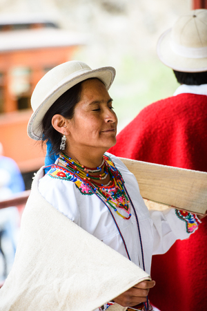 RIOBAMBA, ECUADOR - JAN 7, 2015: Unidentified Ecuadorian woman in traditional clothes and bowler hat. 71,9% of Ecuadorian people belong to the Mestizo ethnic group
