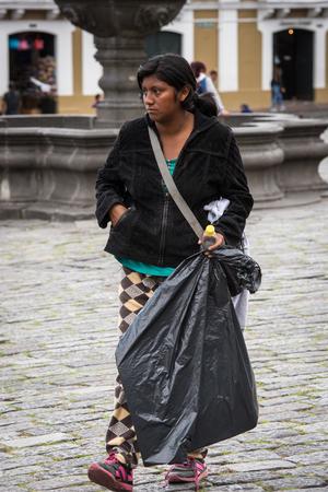 QUITO, ECUADOR - JAN 2, 2015: Unidentified Ecuadorian woman with a black bag. 71,9% of Ecuadorian people belong to the Mestizo ethnic group
