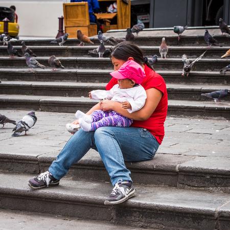 QUITO, ECUADOR - JAN 2, 2015: Unidentified Ecuadorian little girl and her mother. 71,9% of Ecuadorian people belong to the Mestizo ethnic group Éditoriale