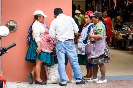 CUENCA, ECUADOR - JAN 9, 2015: Unidentified Ecuadorian people in the street. 71,9% of Ecuadorian people belong to the Mestizo ethnic group Editorial
