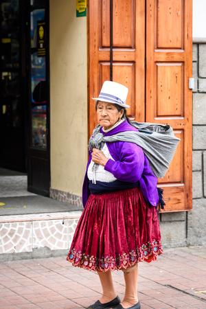 CUENCA, ECUADOR - JAN 9, 2015: Unidentified Ecuadorian woman in traditional clothes in the street. 71,9% of Ecuadorian people belong to the Mestizo ethnic group