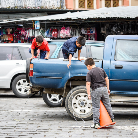 CUENCA, ECUADOR - JAN 9, 2015: Unidentified Ecuadorian people in the back of the car. 71,9% of Ecuadorian people belong to the Mestizo ethnic group