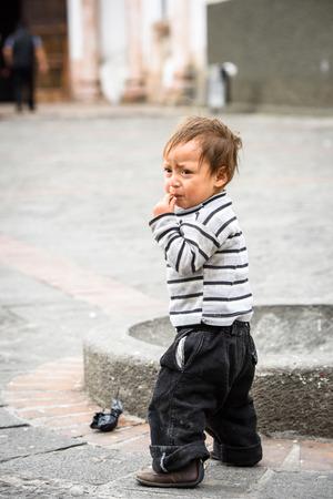 CUENCA, ECUADOR - JAN 9, 2015: Unidentified Ecuadorian boy in the street. 71,9% of Ecuadorian people belong to the Mestizo ethnic group Editorial