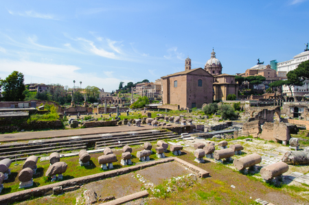 Roman Forum, a rectangular forum surrounded by the ruins of several important ancient government buildings at the center of the city of Rome. Stock Photo