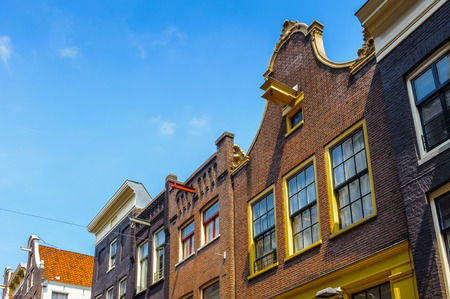 Old bend houses in Amsterdam, Netherlands Stock Photo