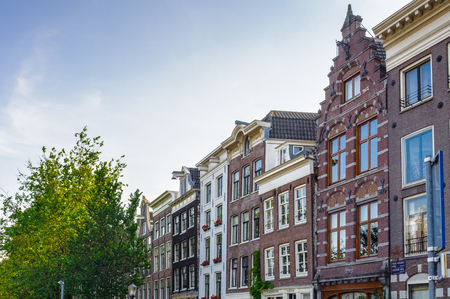 Bend buildings over the river Amstel in Amsterdam, Netherland