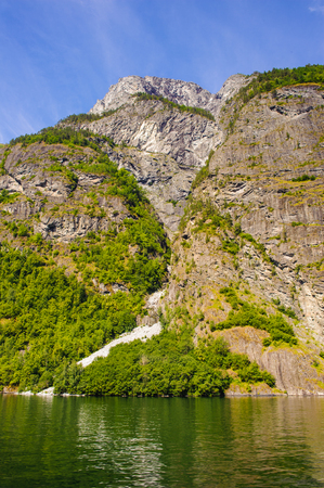 Water fall on the rock of the Sognefjord, Norway