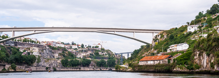 Coast of the River Douro with its beautiful architecture in Porto, Portugal. View from the River Douro, one of the major rivers of the Iberian Peninsula (2157 m)