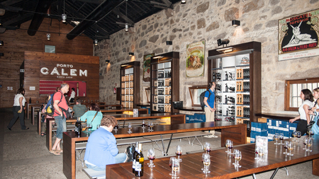 PORTO, PORTUGAL - Interior of the cellar of the port wine of the Calem trademark. Calem company was created in 1859 and now it's one of the world brands of the port wines from Porto Editoriali